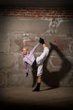 Beautiful hip hop girl dancing over brick wall Stock Images