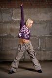 Beautiful hip hop girl dancing over grey brick wal Stock Photo