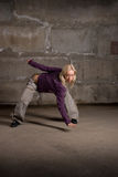 Beautiful hip hop girl dancing over grey brick wal Stock Images