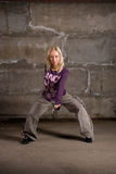 Beautiful hip hop girl dancing over grey brick wall Royalty Free Stock Photography