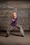 Beautiful hip hop girl dancing over grey brick wall Royalty Free Stock Photography