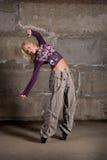 Beautiful hip hop girl dancing over grey wall Royalty Free Stock Photography