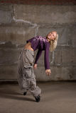 Beautiful hip hop girl dancing over grey wall Royalty Free Stock Photos