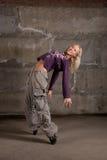 Beautiful hip hop girl dancing over grey wall Royalty Free Stock Photos