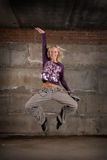 Beautiful hip hop girl dancing over grey wall Stock Photos