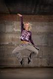 Beautiful hip hop girl dancing over grey wall Stock Photos
