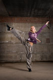 Beautiful hip hop girl dancing over grey wall Stock Image