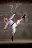 Beautiful hip hop girl dancing over grey wall Royalty Free Stock Images