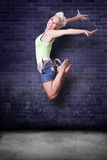 Beautiful hip hop girl jumping Stock Photos