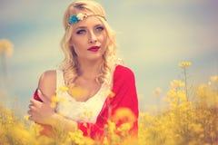 Beautiful hippie girl in field Stock Photo