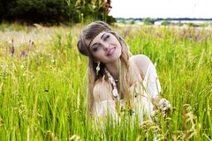Beautiful hippie girl on the green meadow Royalty Free Stock Photo