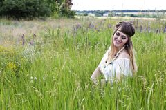 Beautiful hippie girl on the green meadow Royalty Free Stock Photos