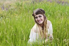 Beautiful hippie girl on the green meadow Stock Photography