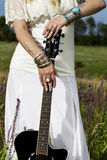 Beautiful hippie girl with a guitar Royalty Free Stock Photos