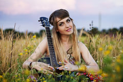 Beautiful hippie girl with a guitar Stock Image