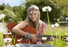Beautiful hippie girl with guitar Royalty Free Stock Photo