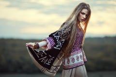 Beautiful hippie girl. Outdoors at sunset. Boho fashion style royalty free stock photos