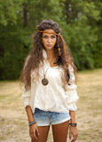 Beautiful hippie girl in the park Royalty Free Stock Image