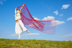 Beautiful hippie girl with red fabric Royalty Free Stock Photography