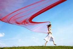 Beautiful hippie girl with red fabric stock photos