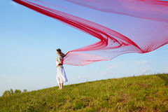 Beautiful hippie girl with red fabric Stock Images