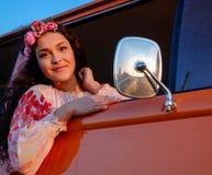 Beautiful hippie girl in a van Stock Photos