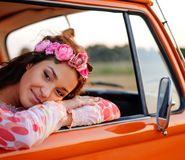 Beautiful hippie girl in a van Royalty Free Stock Image