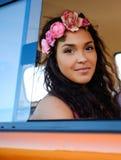 Beautiful hippie girl in a van Stock Image