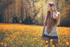 Beautiful hippie woman in flower field Stock Photos