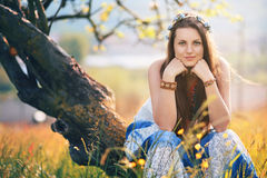 Beautiful hippie woman posing in a summer field Royalty Free Stock Images