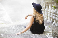 Beautiful hippie young woman wearing boho chic clothes. And black hat outdoors Stock Photo