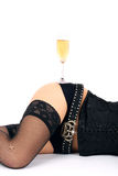 Beautiful hips and champagne glass Stock Photography