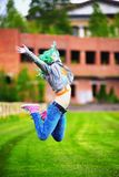 Beautiful hipster alternative young woman with green hair jump Stock Photography