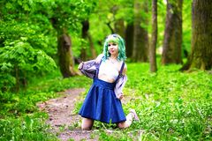 Beautiful hipster alternative young woman with green hair in park Royalty Free Stock Photos