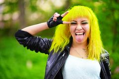 Beautiful hipster alternative young woman with yellow hair in park Royalty Free Stock Photography