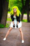 Beautiful hipster alternative young woman with yellow hair in park Stock Photos