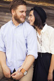 Beautiful hipster couple in love on a date outdoors in park havi Royalty Free Stock Photography