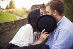 Beautiful hipster couple in love on a date outdoors in park havi Royalty Free Stock Image