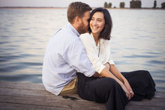 Beautiful hipster couple in love on a date outdoors in park havi Stock Photography
