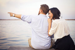 Beautiful hipster couple in love on a date outdoors in park havi Royalty Free Stock Images
