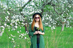 Beautiful hipster girl in apple garden. stock photos