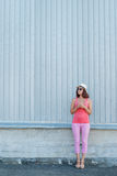 Beautiful hipster girl with ice cream in hand. Royalty Free Stock Photos