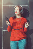 Beautiful hipster girl listening music Stock Photography