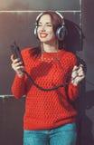 Beautiful hipster girl listening music Stock Photo