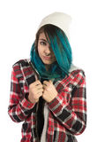 Beautiful hipster girl looking fearfully at camera. On white background. Pierced, turquoise haired and dressing up a plaid shirt Royalty Free Stock Photos