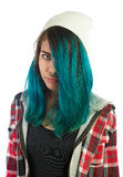 Beautiful hipster girl looking seriously at camera. On white background. Pierced, turquoise haired and dressing up a plaid shirt Royalty Free Stock Photography