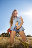 Beautiful hipster girl on a meadow - morning shot Royalty Free Stock Images