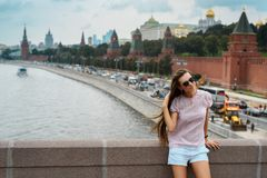 Beautiful hipster girl on the Moscow city background. Russia, Moscow, Red Square, Moskva river - 2016. royalty free stock photos