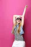 Beautiful hipster girl. Portrait of a beautiful hipster girl on pink background Stock Photos