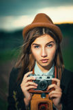 Beautiful hipster girl shooting Stock Image